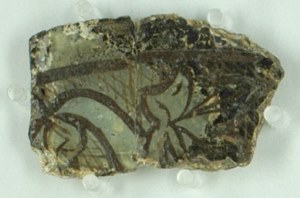 Decorated glass fragment found in excavation.