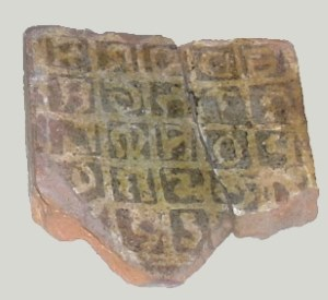 Tile found in excavation.
